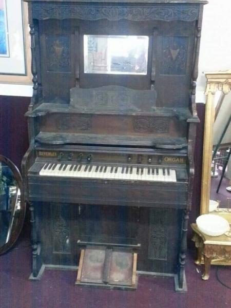 A very beaten up piano that needed some TLC to make it handsome again.