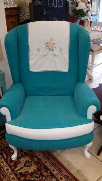 We gave this chair an updated look with a bright blue upholstery and white accents.
