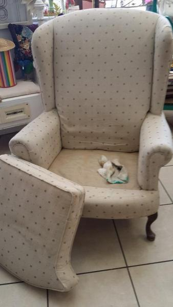 A customer brought this chair in for a makeover, notice the nice construction but stained upholstery.