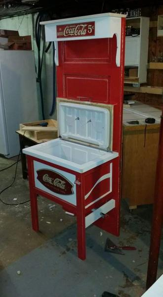 This red and white cooler is actually attached to a door so it stands sturdy. We love Coca Cola around here and this is one of our favorite pieces!